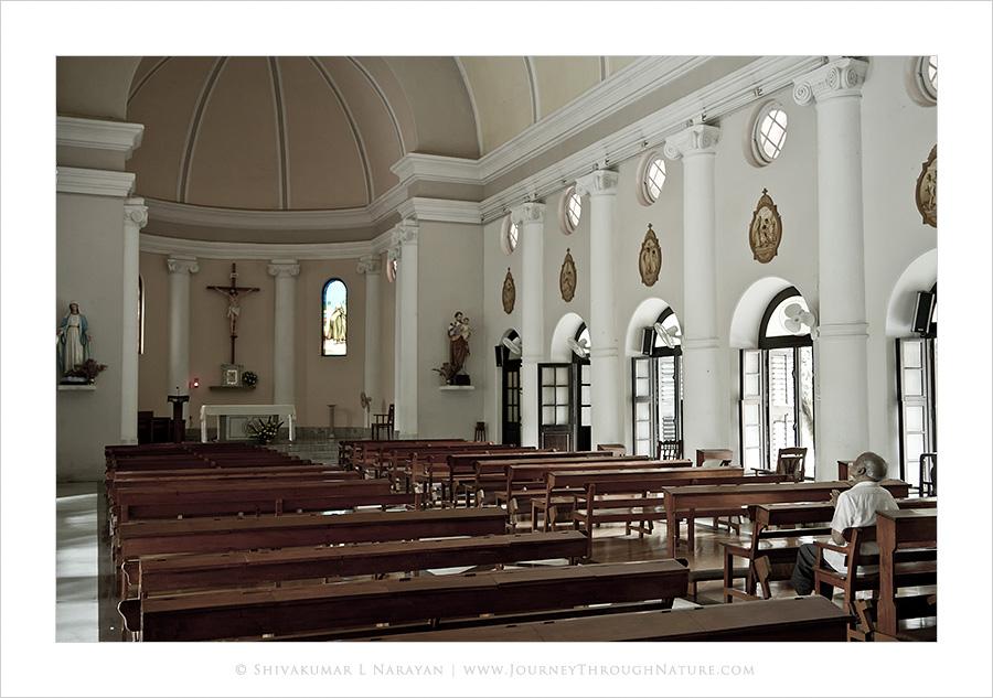 Lone man praying in a church